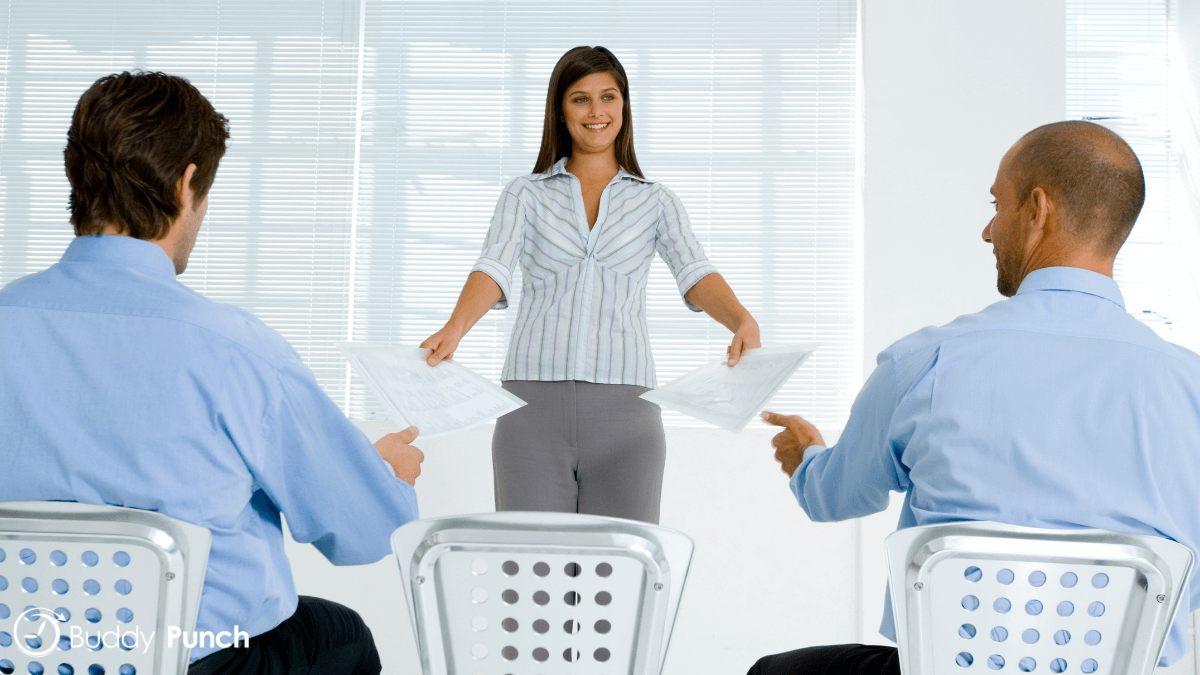 Woman delegating tasks to her employees.