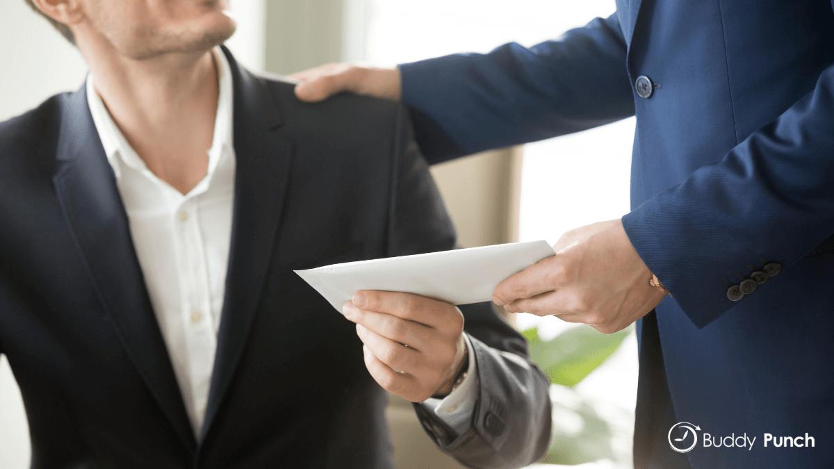 Management handing an employee a bonus for doing great work.