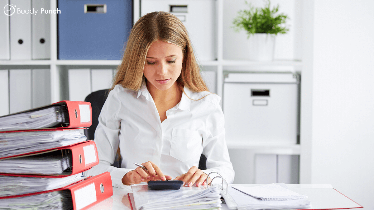 Woman doing manual payroll for their business.