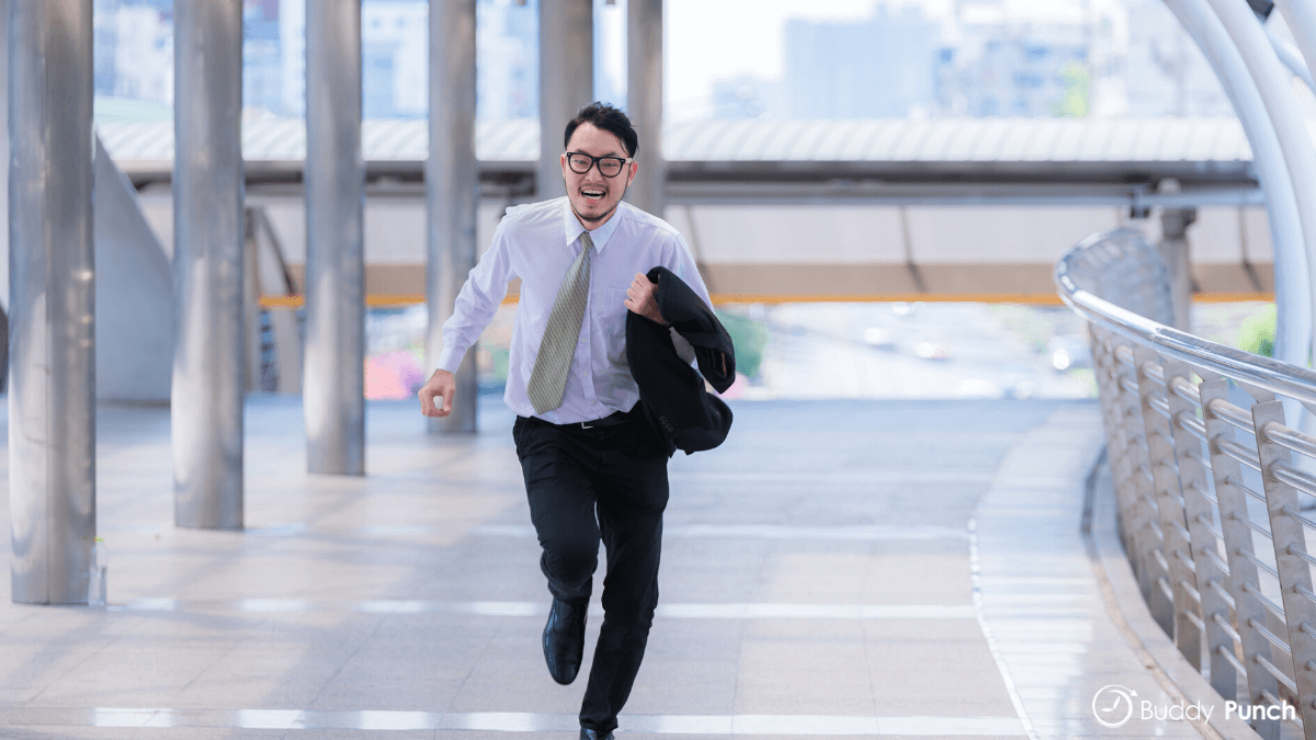 Employee who is late to work running to make sure they don't arrive any later.