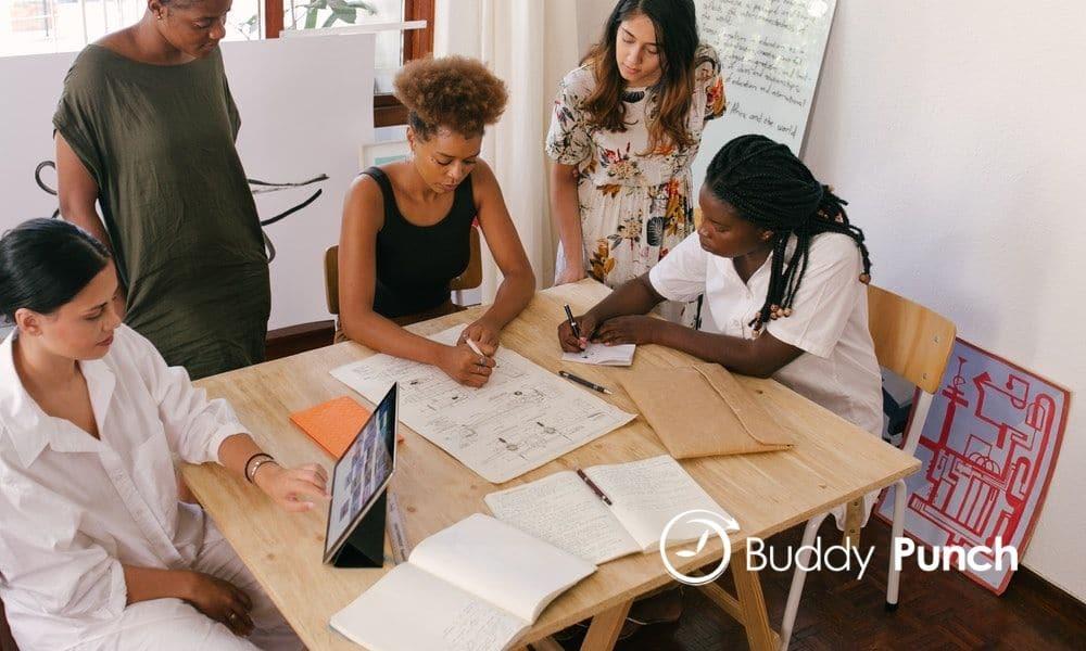 women at desk in meeting